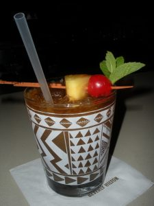 Forget the little umbrella; a Trader Vic's Mai Tai is always garnished with pineapple, a stemless maraschino cherry and fresh mint.