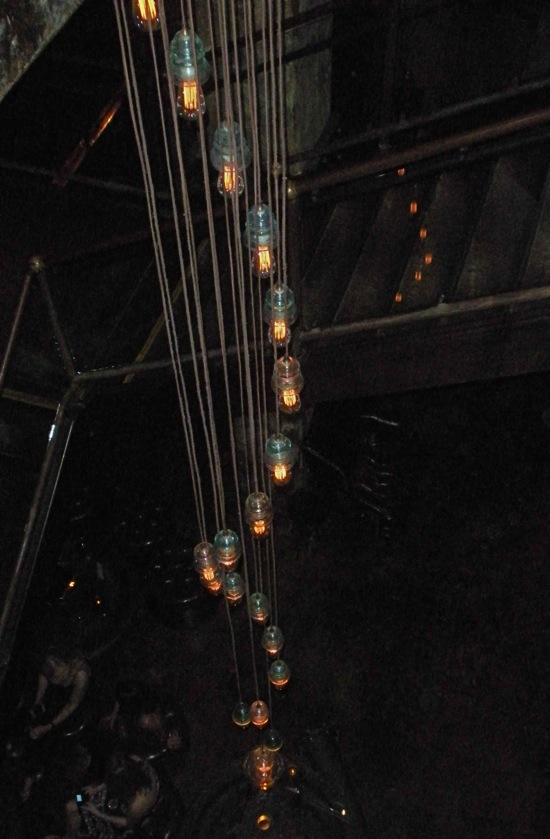 This unique light fixture at The Edison in LA features tungsten filament bulbs and vintage glass insulators. (Photo by Maria C. Hunt)