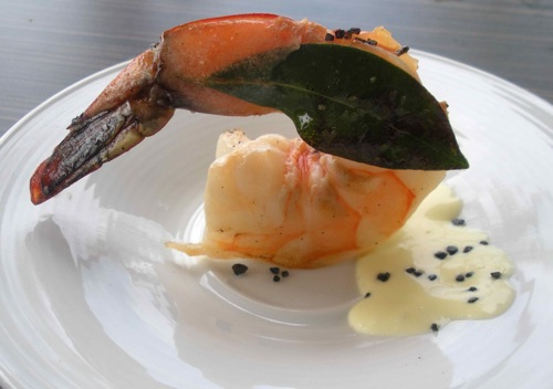 A giant prawn is served seared with a bay laurel leaf, citrus aioli and black salt.(Photo by Maria C. Hunt)