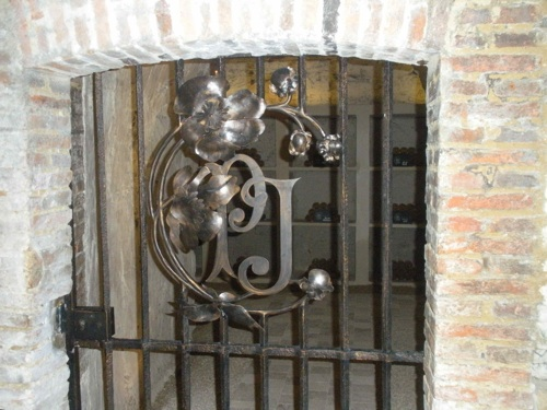This gate leads to the caves where Perrier Jouet champagne is stored during aging. (Photo by Maria C. Hunt)