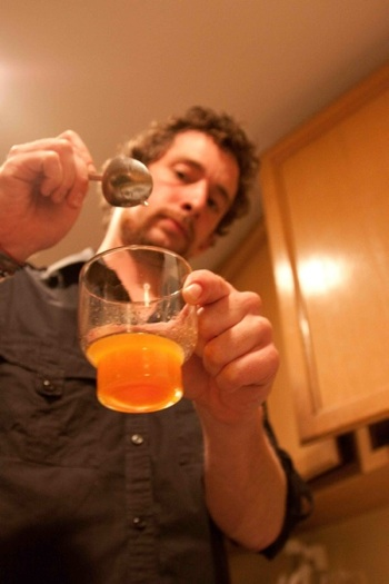 Ian Ward mixing Panhandler's Punch at a speakeasy night somewhere in San Diego. (Photo by Michael Esposito)